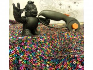 A warm welcome to the newest addition to the Abstract Roots team – ROCK ON FREDDIE! Freddie is busy cutting out rainbow sequin fabric for a handful of fanny packs headed to a bridal party while rocking out to @umphreysmcgee m/ #abstractroots #mailchimp #rockonfreddie #freddie #gimletmedia #replyall #nofreddieswereharmedinthemakingofthesefannypacks #fannypack #sequin #handmade @gimletmedia @mailchimp